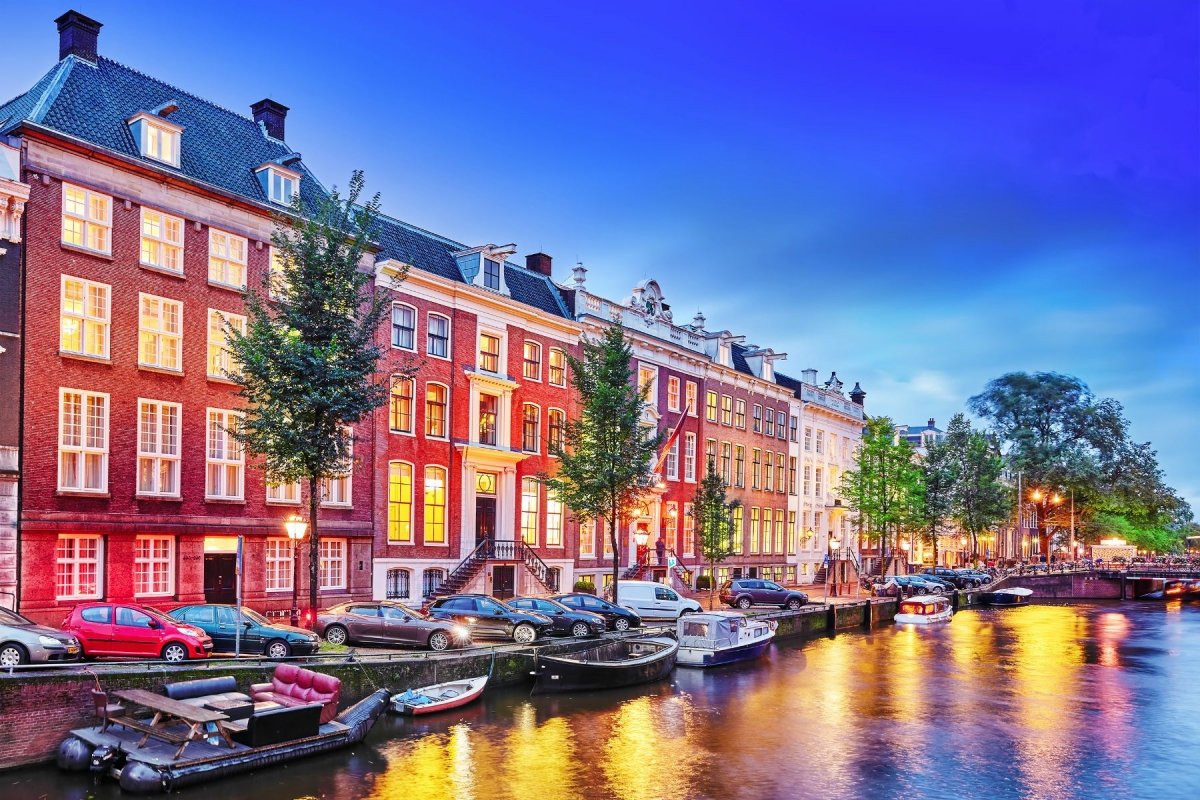 Amsterdam city at the evening time.